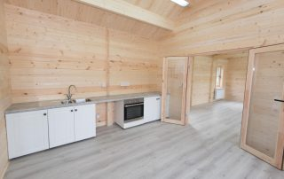 fitted kitchen in log cabin school