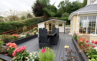 cabin decking project with garden furniture