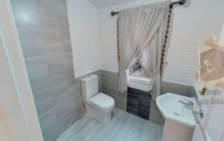 bathroom fitted in log cabin