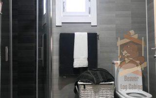 bathroom built into log cabin
