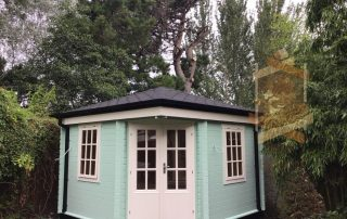log cabin jos painted in mint green