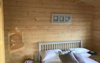 bedroom inside log cabin